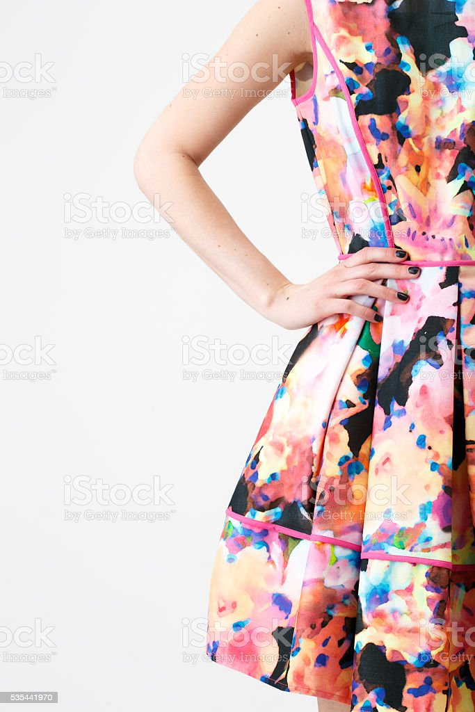 Woman in a multicolor dress stock photo