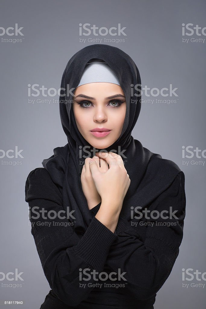 Woman in a Muslim headscarf hijab stock photo
