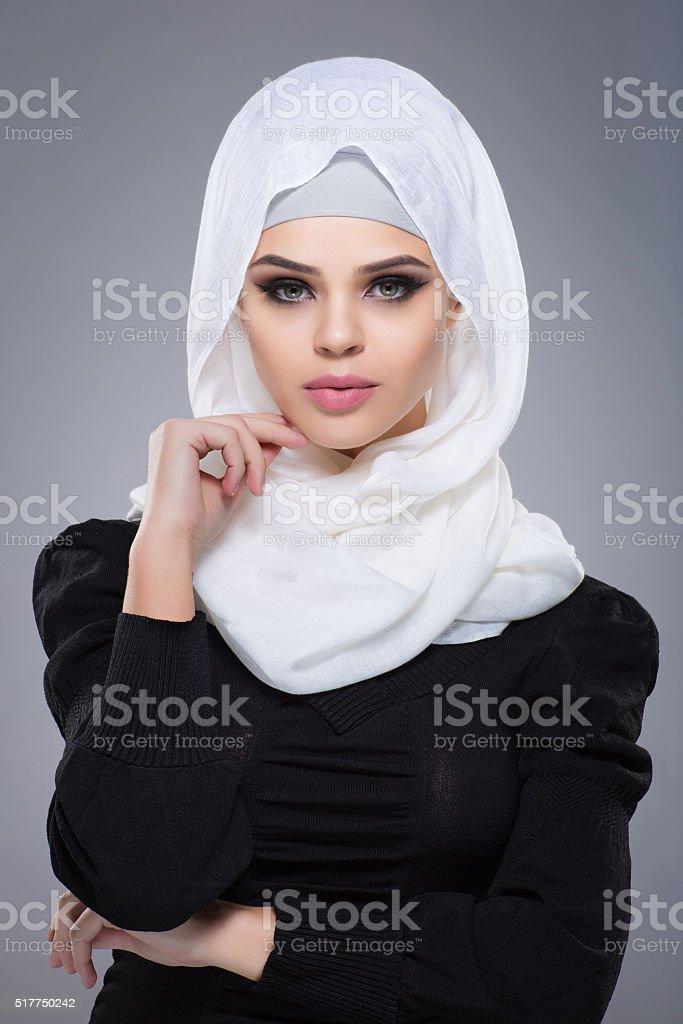 Woman in a Muslim scarf hijab stock photo