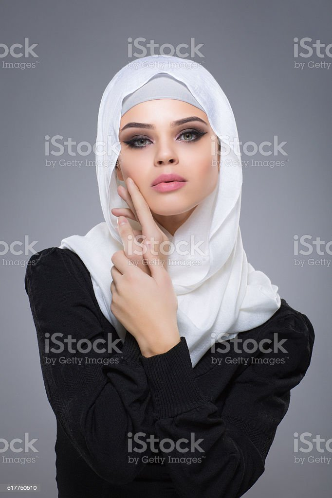 Woman in a Muslim scarf hijab stock photo