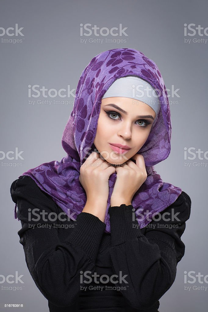 Woman in a Muslim scarf stock photo