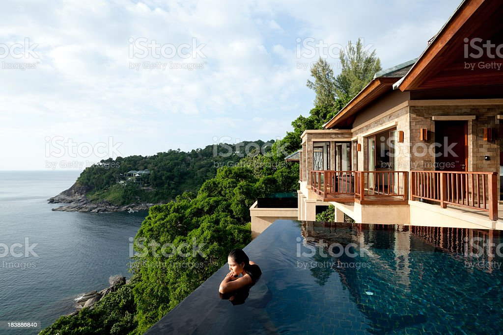 A woman in a oil overlooking Phuket, Thailand stock photo