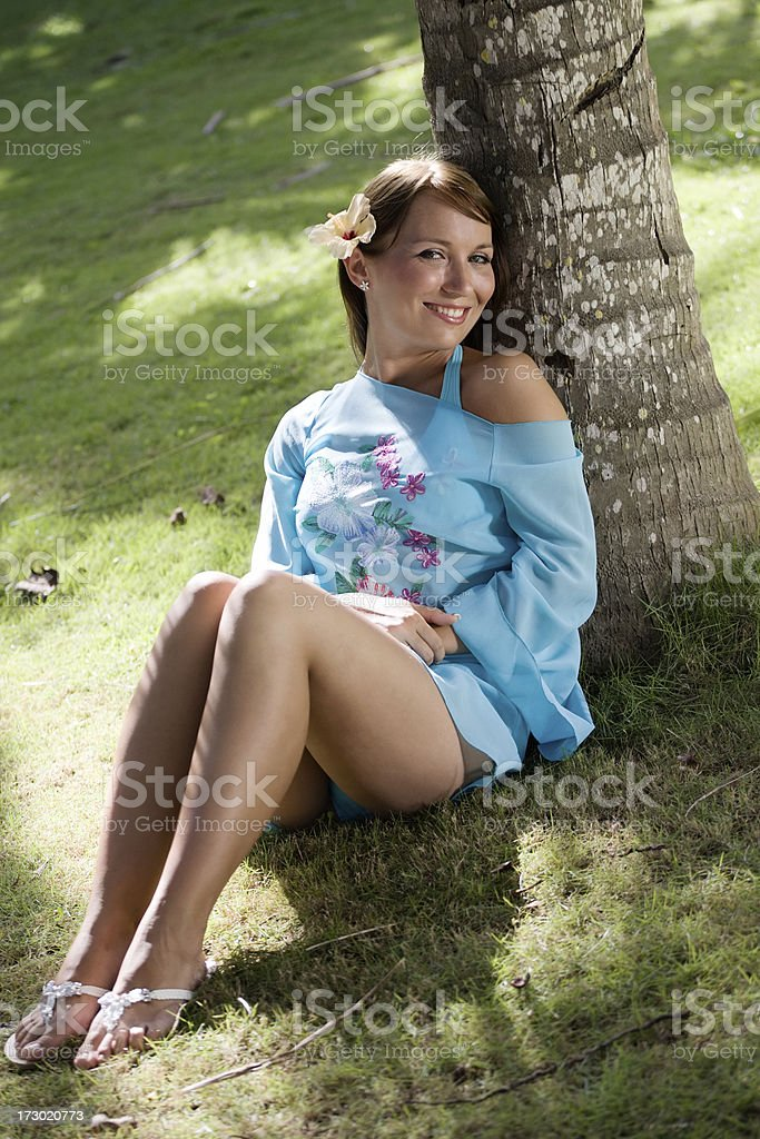 Woman in a palm grove stock photo