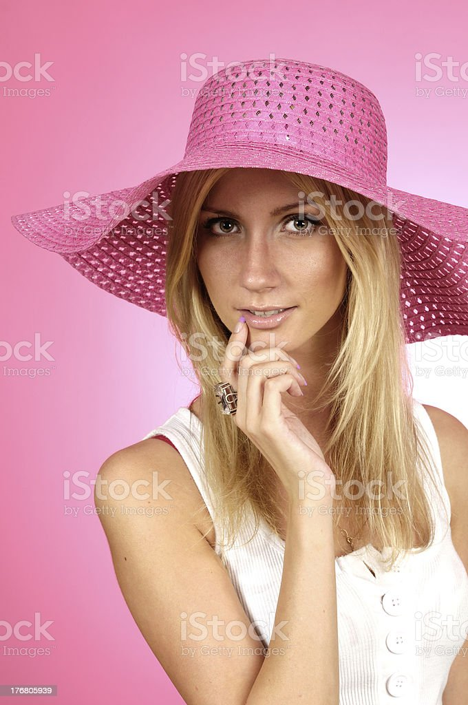 woman in a pink hat royalty-free stock photo
