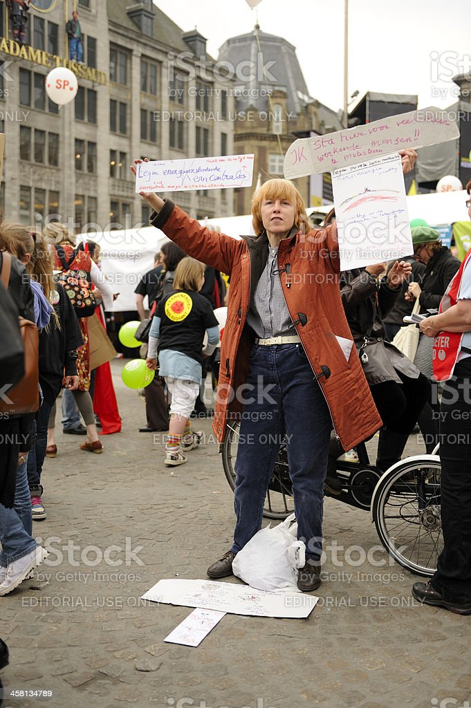 Woman in a protest against nuclear energy, Dam Square, Amsterdam royalty-free stock photo