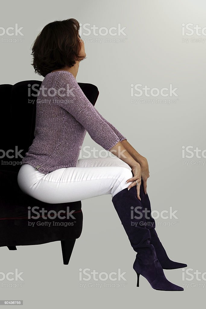Woman in a purple chair royalty-free stock photo