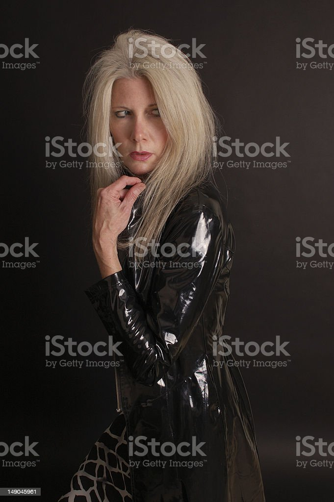 woman in a rain coat royalty-free stock photo