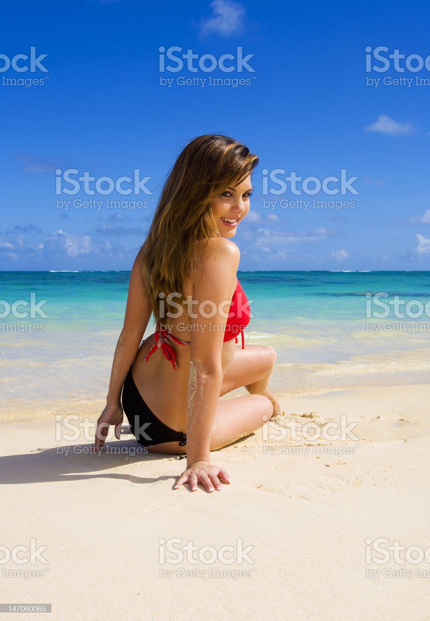 woman in a red bikini sitting royalty-free stock photo