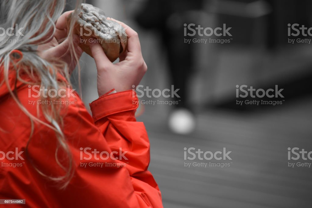 Woman in a red coat - Times Square stock photo