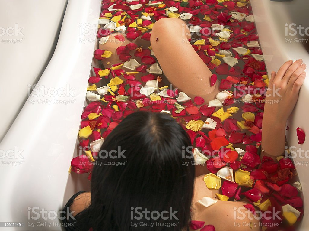 woman in a rose petal bath royalty-free stock photo
