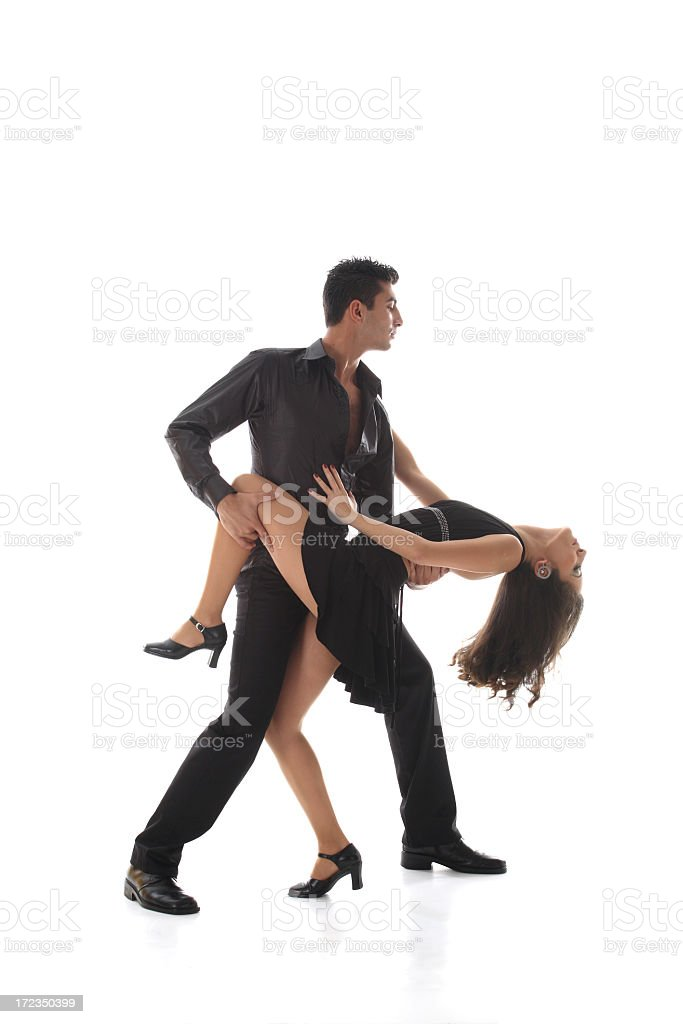Woman in a short black dress dirty dancing with a man royalty-free stock photo