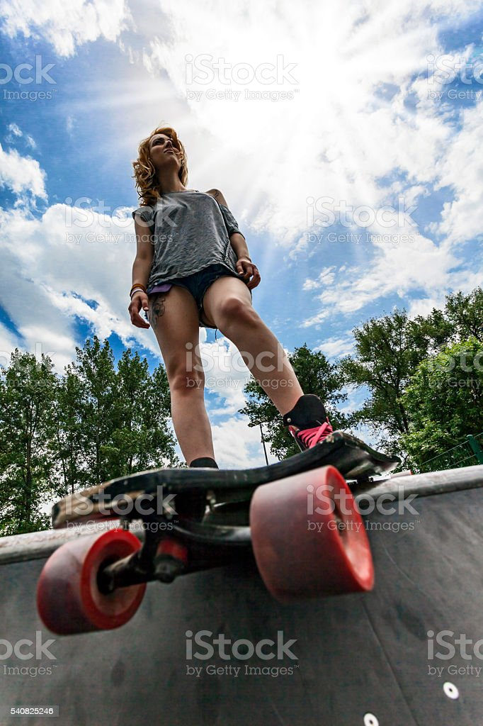 Woman in a skate park stock photo