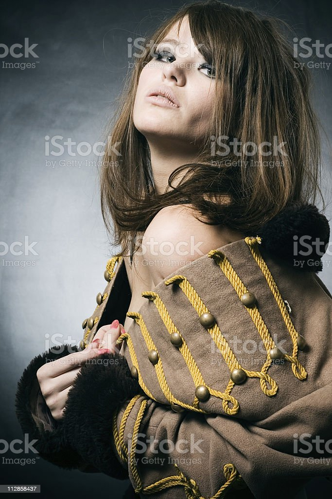 woman in a suit of the hussar. stock photo