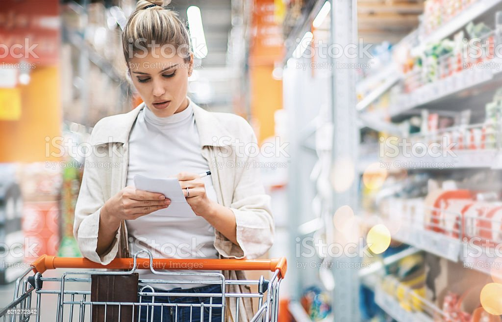 Woman in a supermarket. stock photo