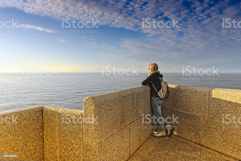 Woman in a terrace over the sea. stock photo