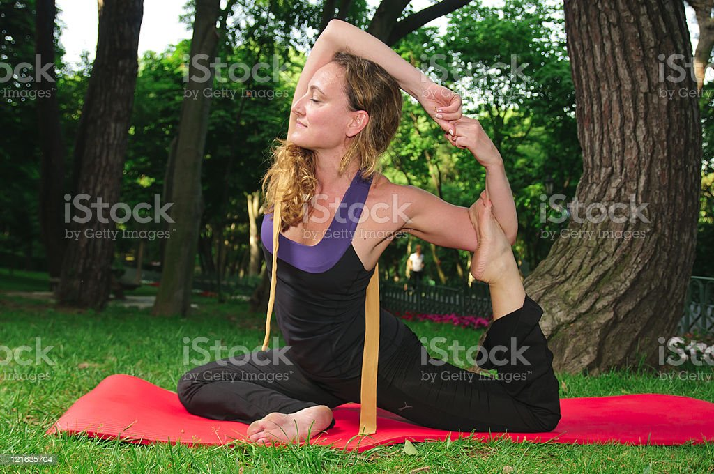 Woman in a traditional yoga stock photo