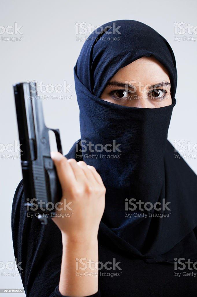 Woman in a veil holding gun stock photo