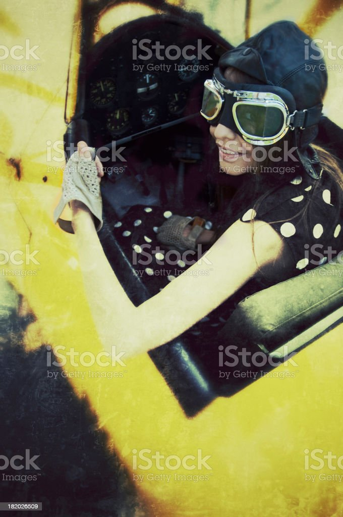 Woman in a vintage airplane royalty-free stock photo