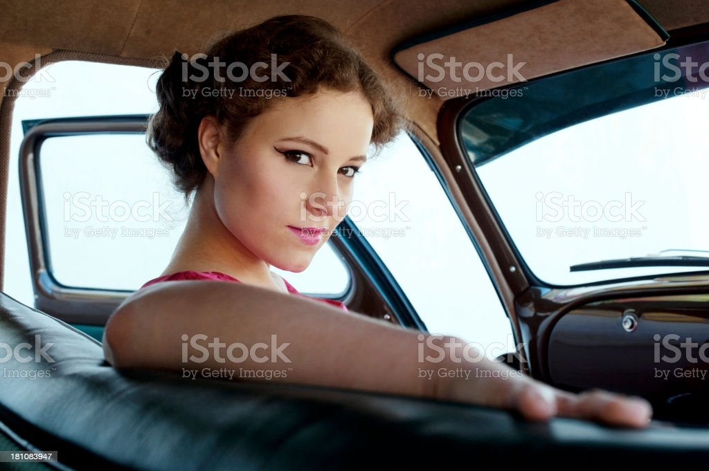 Woman in a Vintage Car 1950-1960 Style royalty-free stock photo