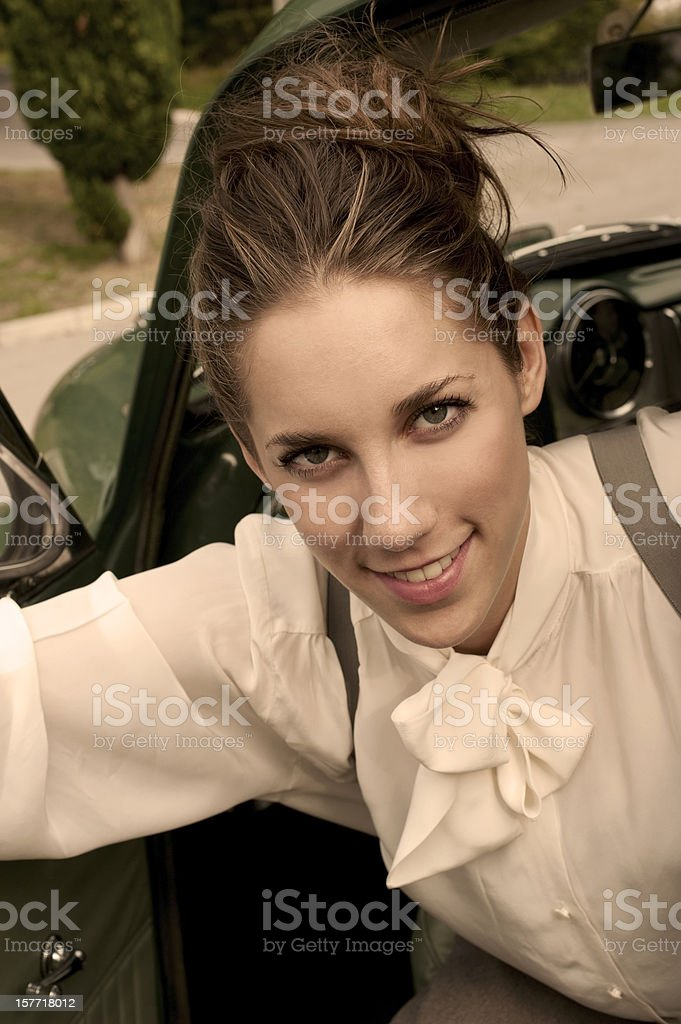 Woman in a Vintage Car royalty-free stock photo