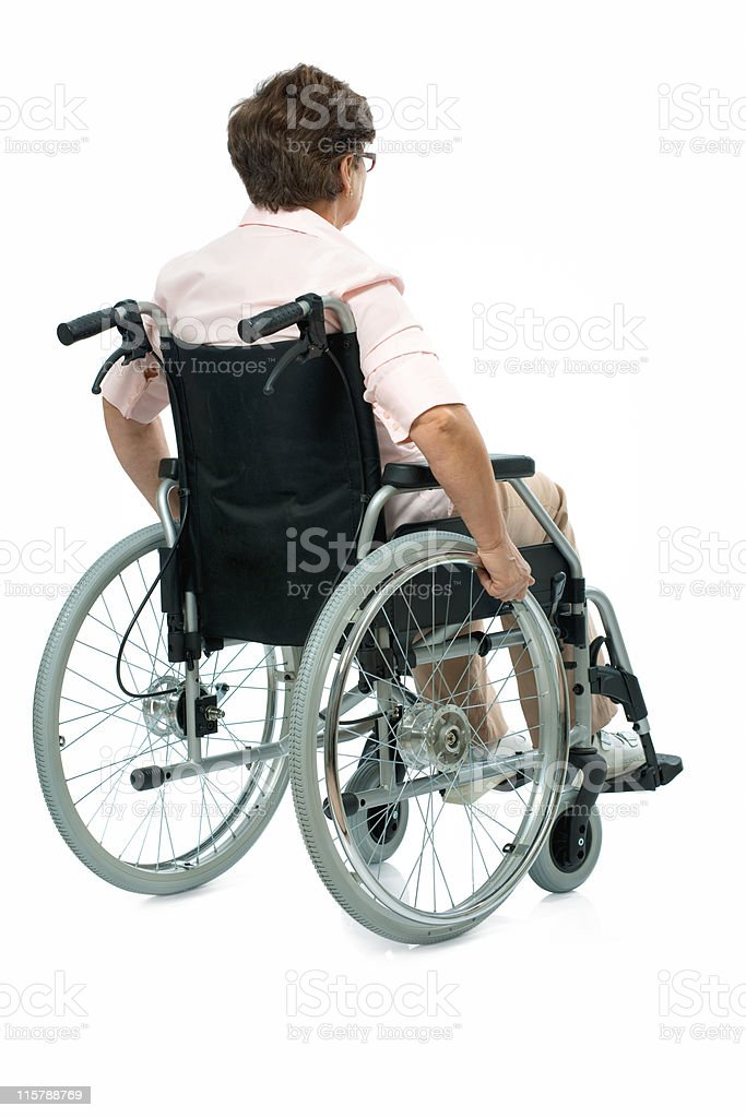 woman in a wheelchair royalty-free stock photo