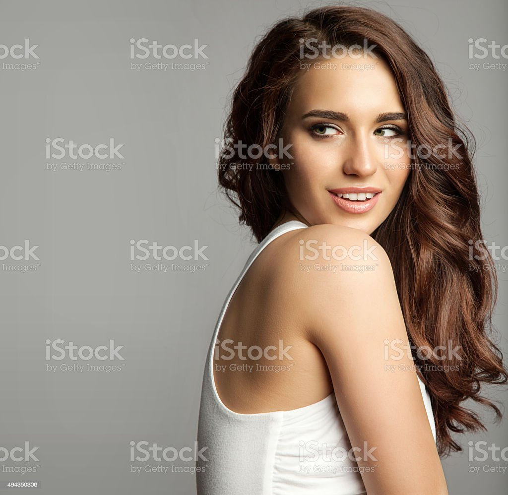 Woman in a white dress with a long hair stock photo