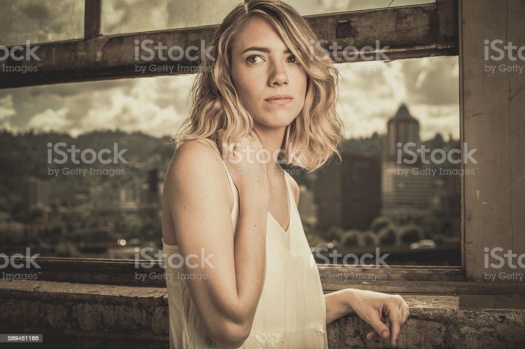 Woman in a Window stock photo