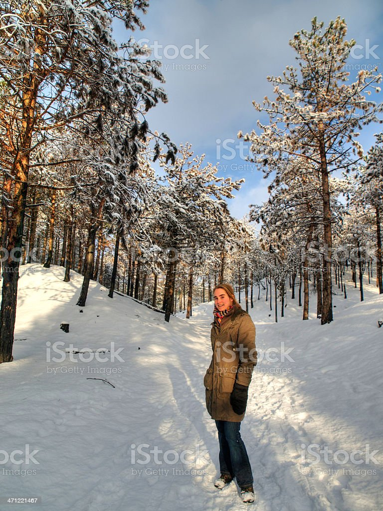 Woman in a winter forest stock photo