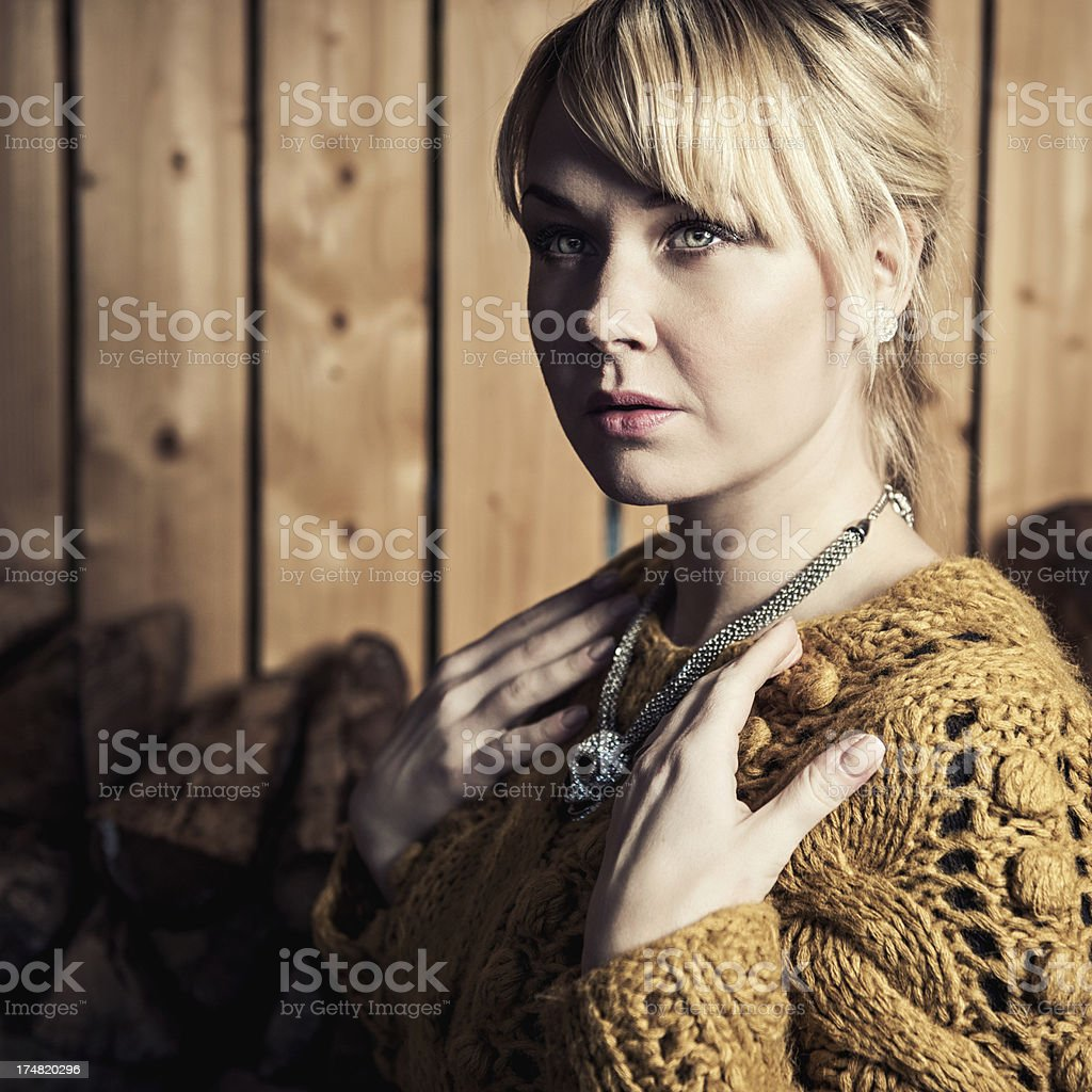 Woman in a woodshed royalty-free stock photo