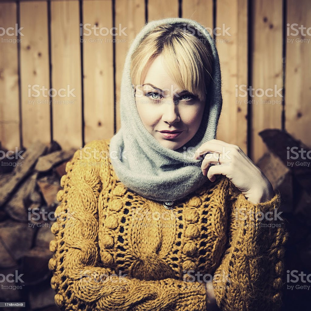 Woman in a woodshed stock photo