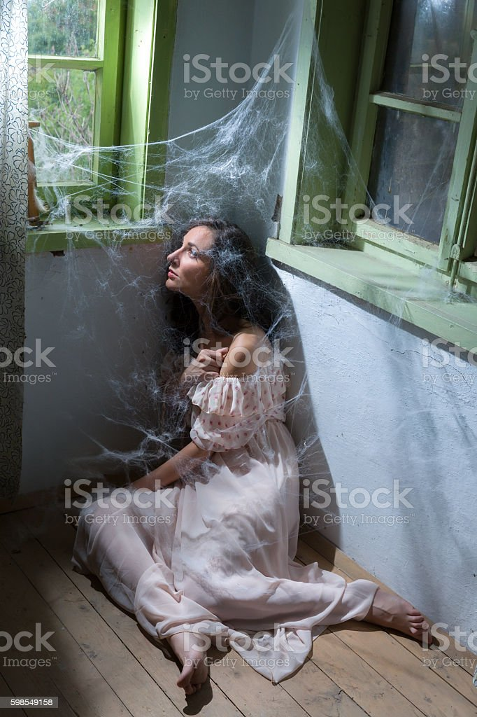 Woman in abandoned room stock photo