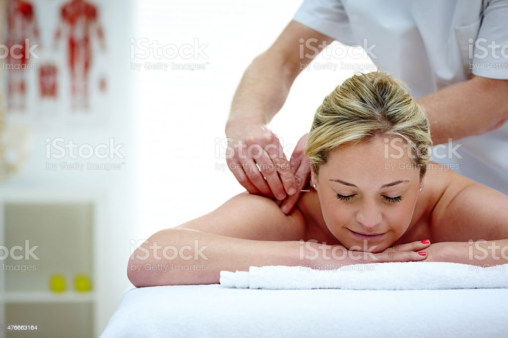 Woman in an acupuncture therapy at spa stock photo