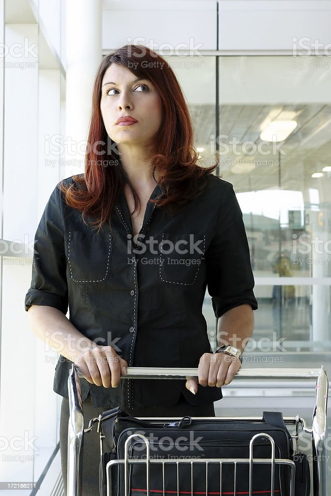 Woman in an airport royalty-free stock photo