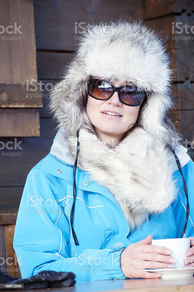 Woman in an apres ski cafe after skiing royalty-free stock photo