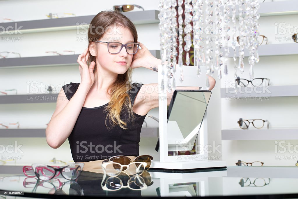Woman in an eyewear store stock photo