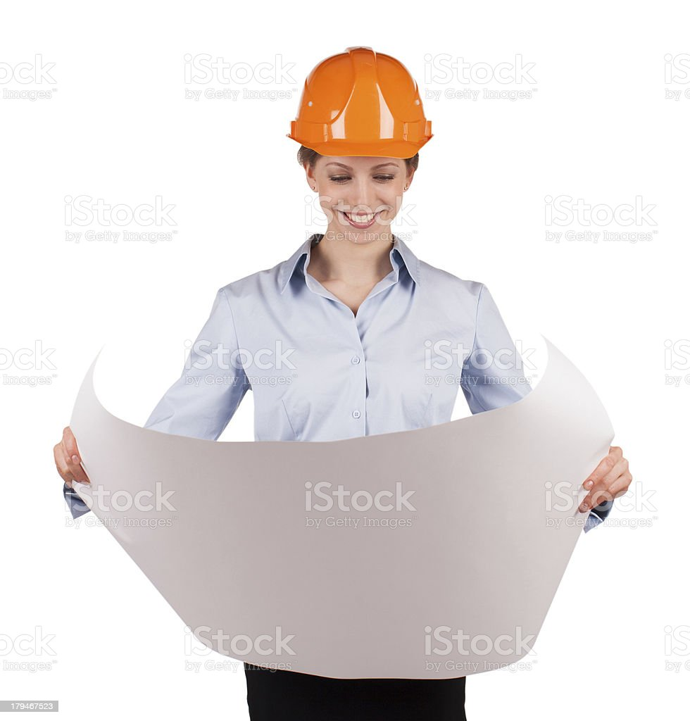 Woman in an protective helmet looks drawing royalty-free stock photo