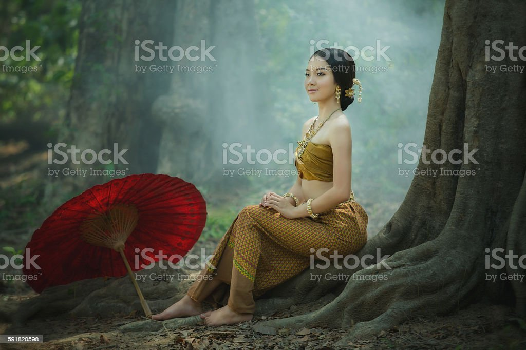 Woman in ancient Thailand, young Myanmar stock photo