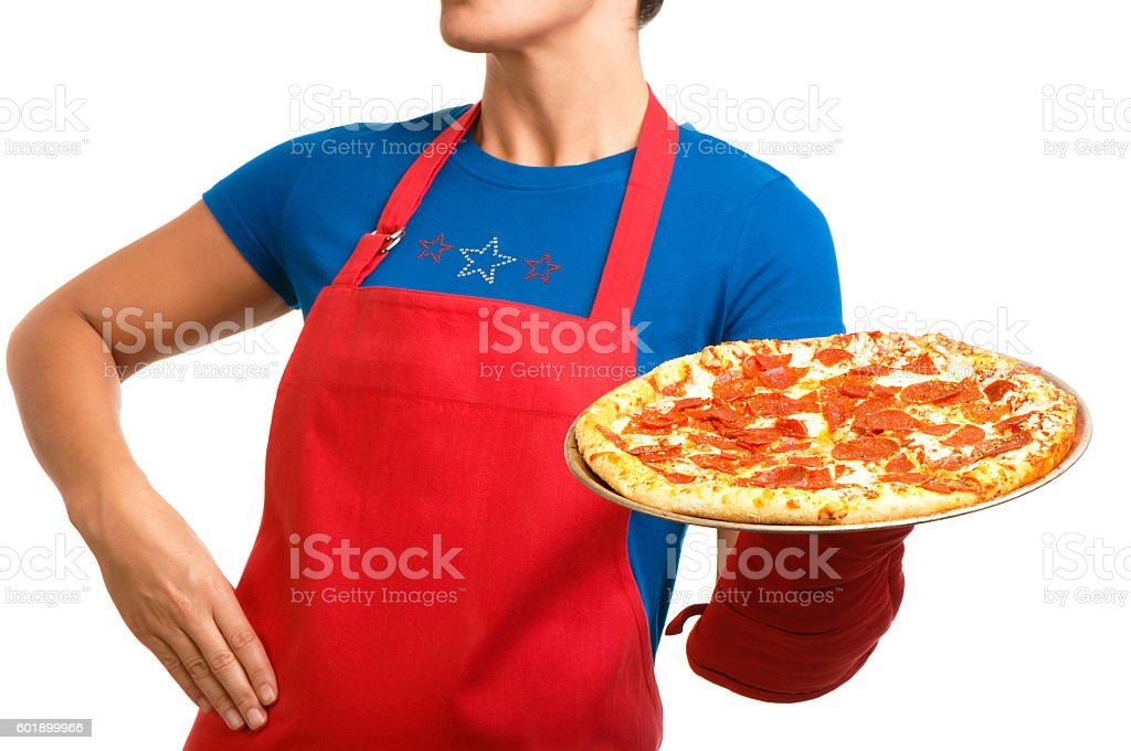 Woman in apron with pepperoni pizza on white stock photo