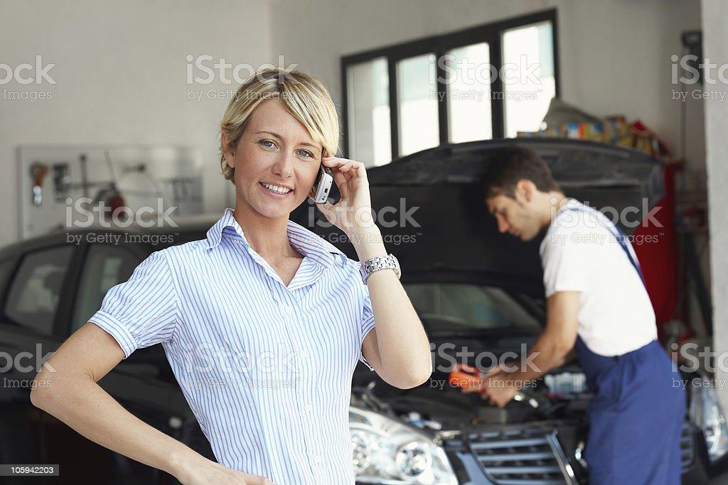 woman in auto repair shop stock photo