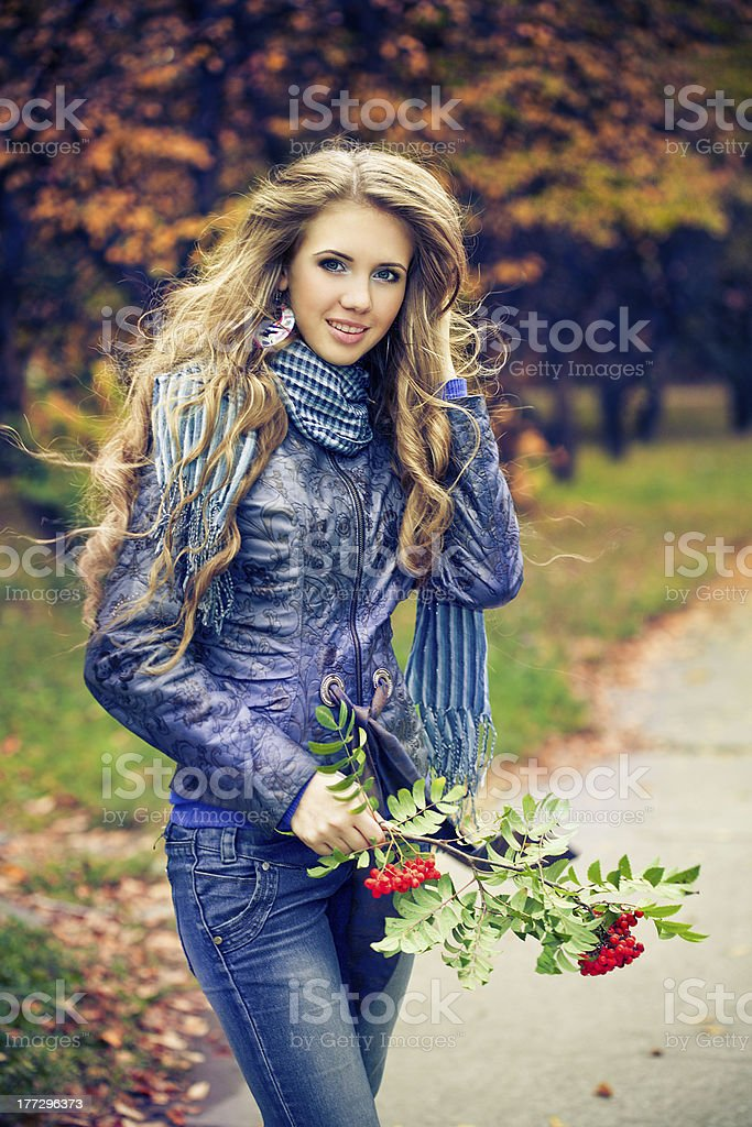 woman in autumn park royalty-free stock photo