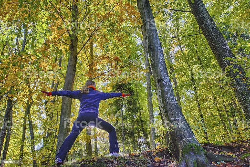 Woman in autumn wood doing Joga, HDR royalty-free stock photo