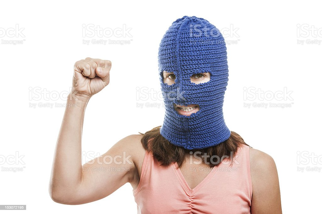 Woman in balaclava showing raised fist gesture royalty-free stock photo