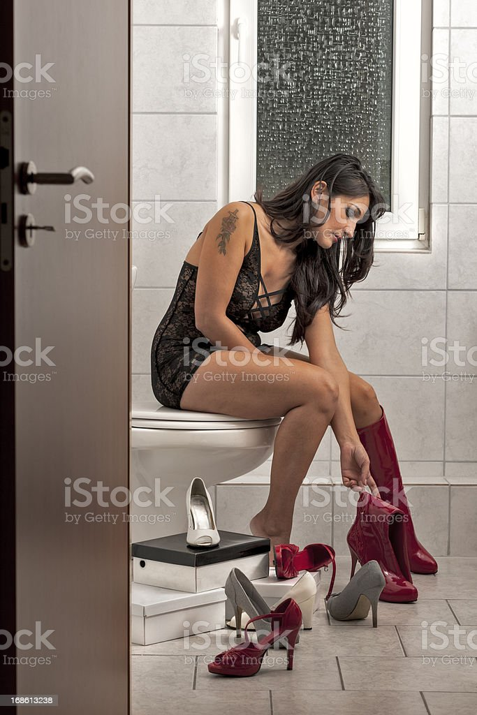 Woman in bath with shoes royalty-free stock photo