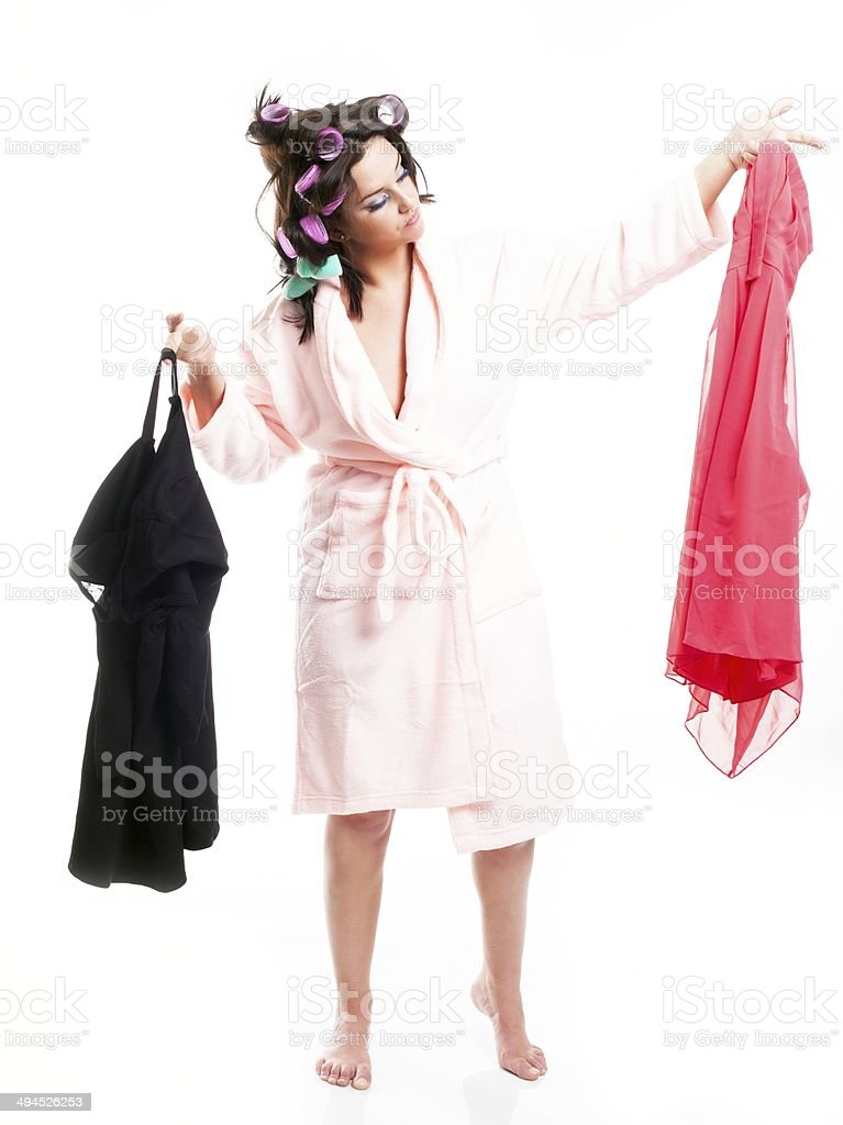 Woman in bathrobe choosing clothes royalty-free stock photo