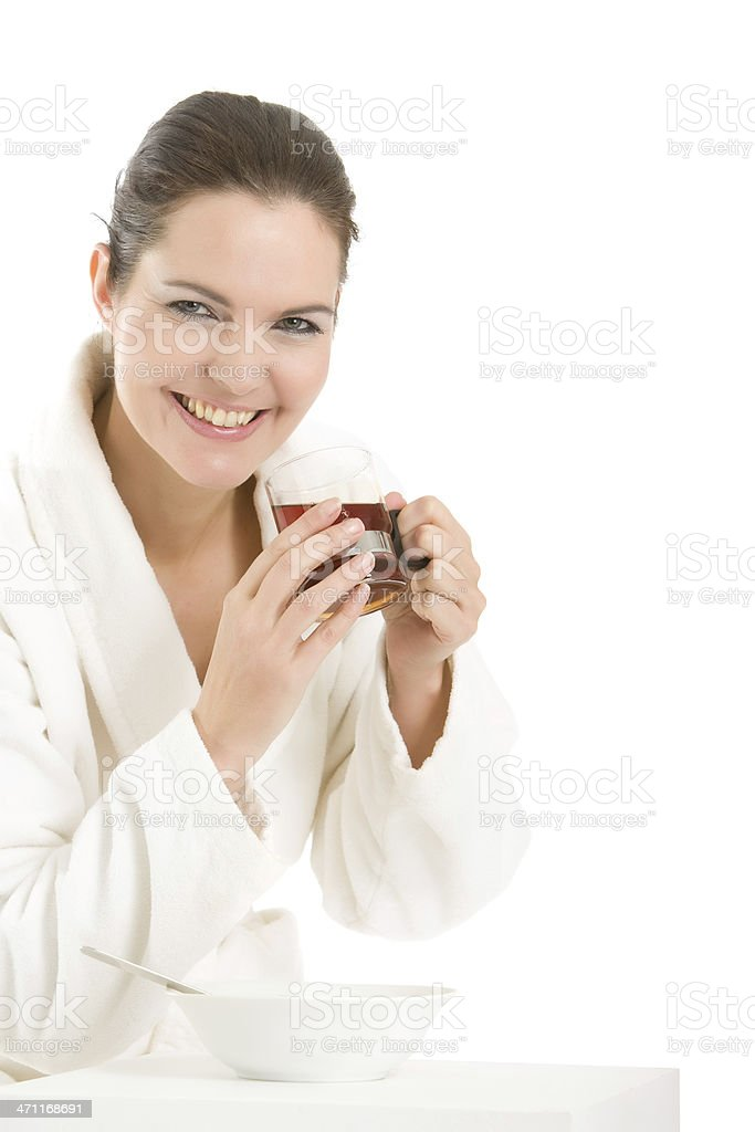 Woman in bathrobe drinking tea stock photo