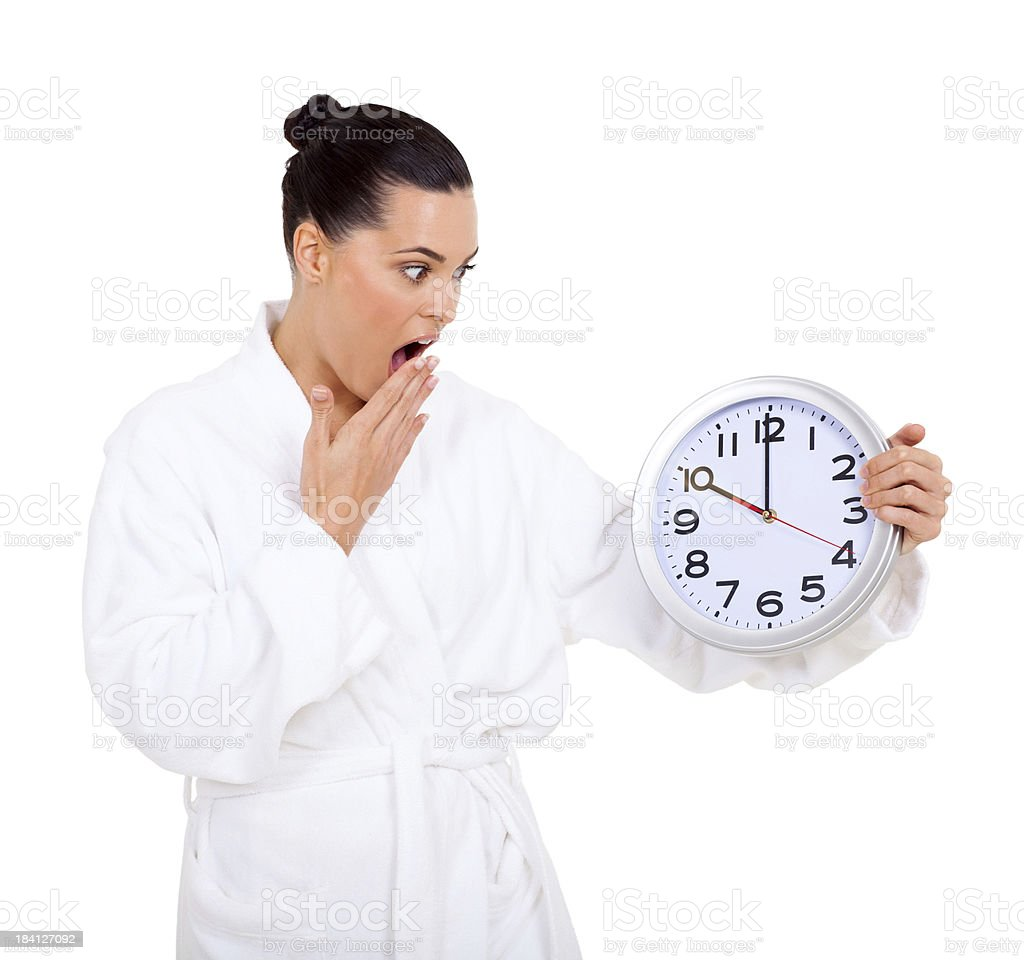 woman in bathrobe looking at the clock royalty-free stock photo
