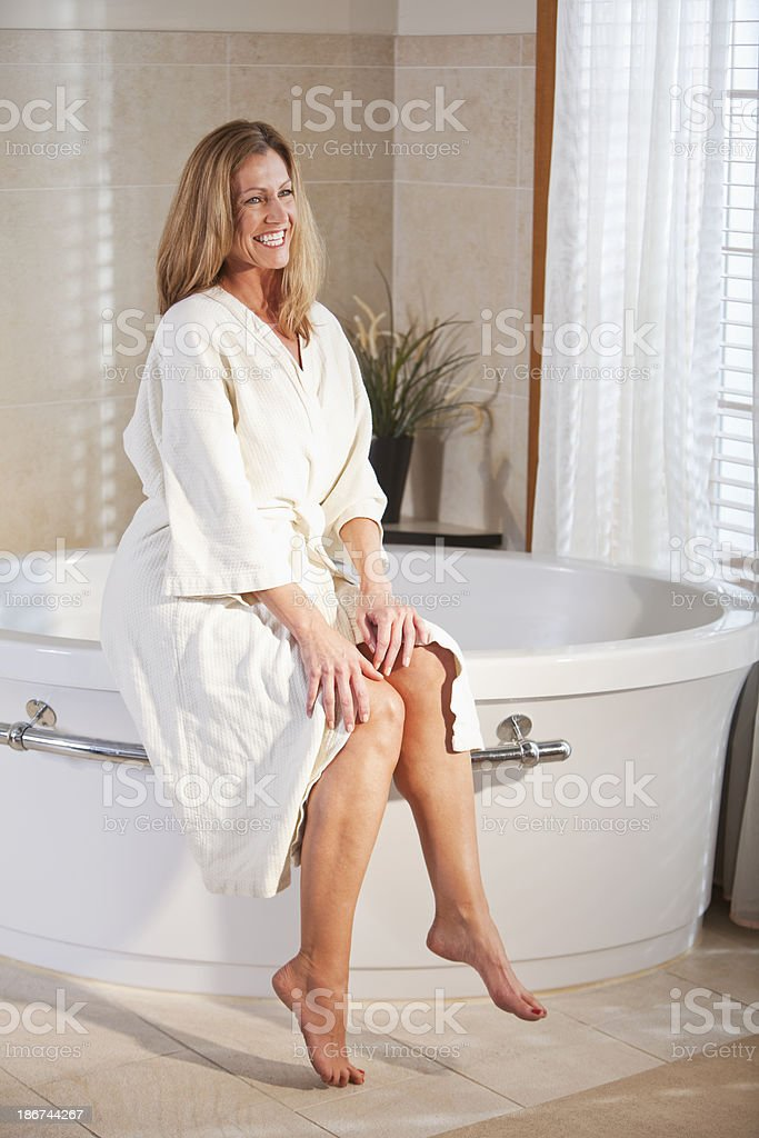 Woman in bathrobe royalty-free stock photo