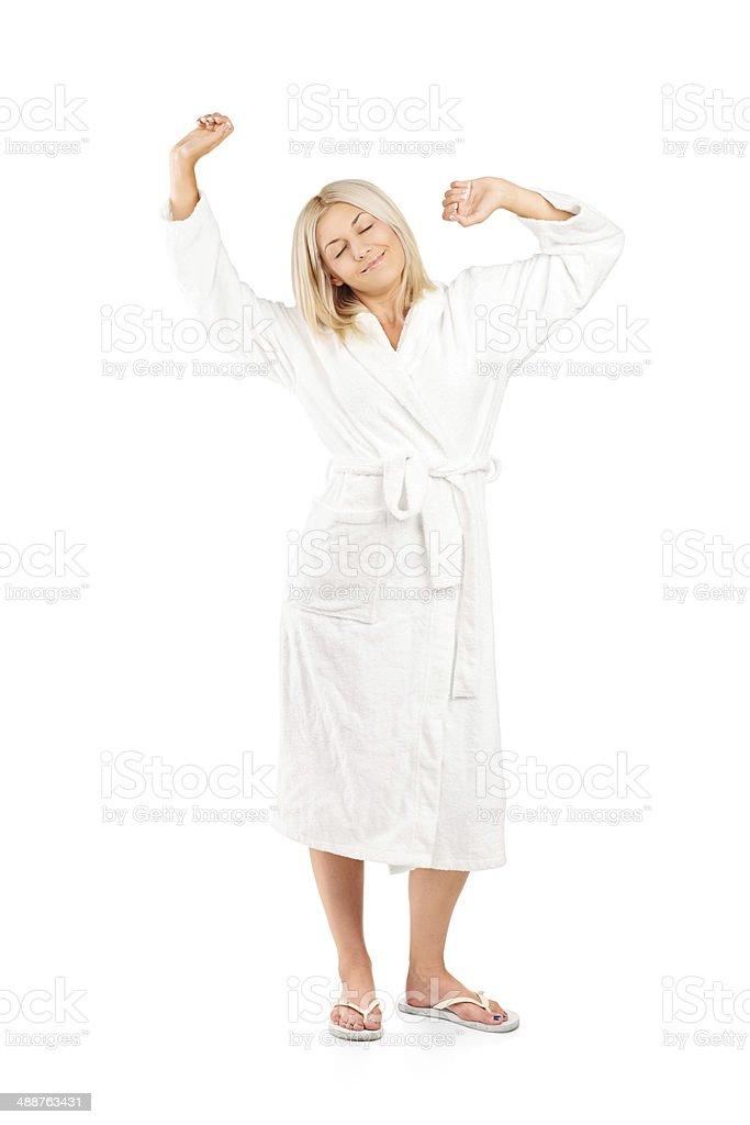 Woman in bathrobe stretching stock photo