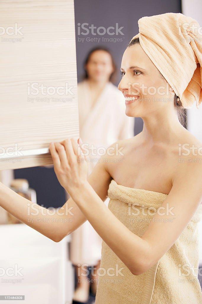 Woman in bathroom royalty-free stock photo