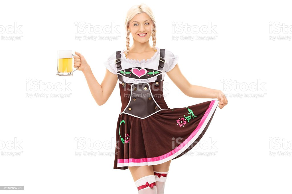 Woman in Bavarian costume holding a pint of beer stock photo